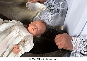 Priest baptizing baby