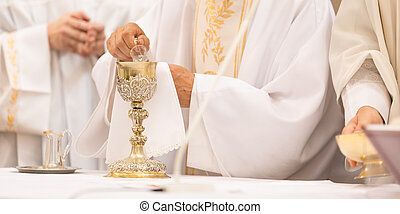 Priest' hands during a wedding ceremony/nuptial mass - ...