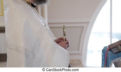 Priest praying with Bible book in church - Priest praying...