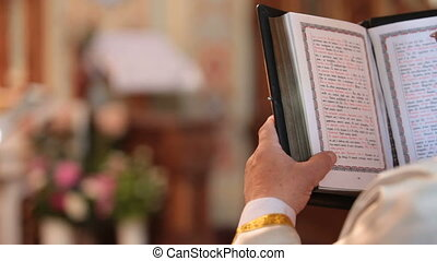 priest reading Bible