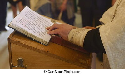 Priest reading the Bible in church