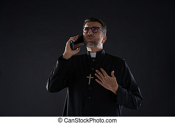 Priest talking smartphone funny expression