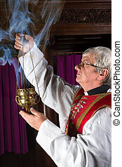 Priest with incense burner