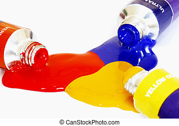 Primary Colours - Red yellow and blue acrylic paints pouring...