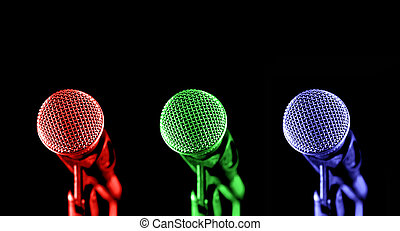 primary colored microphones on black