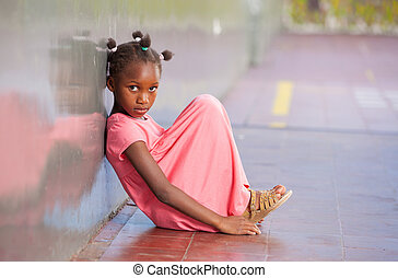 Primary school afro american girl frustrated in schoolyard