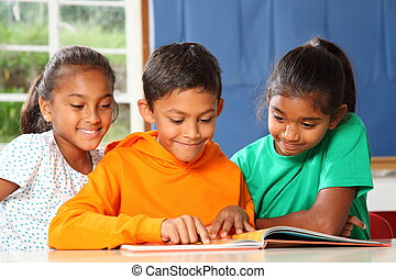 Primary school children in class - Cheerful young primary ...