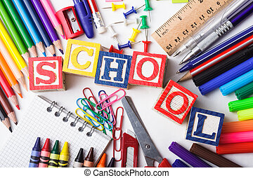 Primary school stationery on a white background