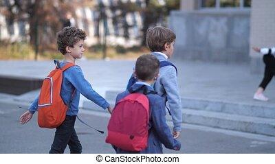 Primary school students walking to school