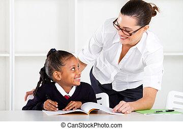 primary school teacher and pupil