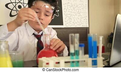 Primary schoolboy in science lab smiling - Schoolboy...