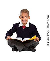 primary schoolboy sitting on floor