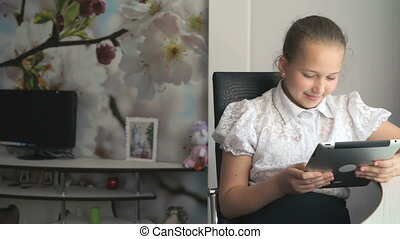 Primary schoolgirl using a digital tablet computer