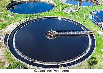Primary sedimentation stage, sewage flows through large tanks