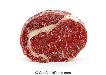 A frozen cut of outer side of the rib : prime rib eye steak isolated on a white background