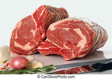 Prime rib raw beef roast on white.