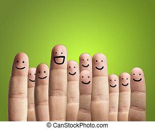 primer plano, de, dedos, con, cara sonriente