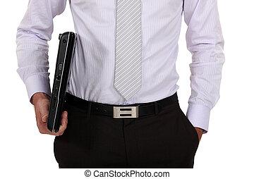 primer plano, de, hombre de negocios, tenencia, computador portatil