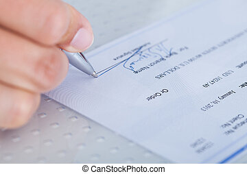 primer plano, de, mano, relleno, cheque