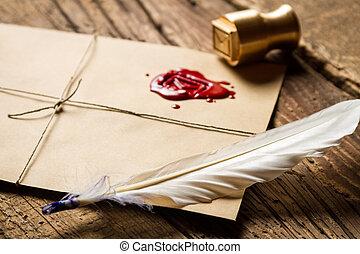 primer plano, de, pluma, en, sobre, con, rojo, sellador, y, sello metal