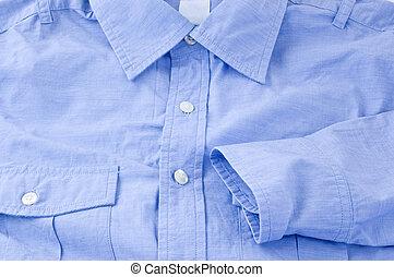 primer plano, de, un, azul, shirt.