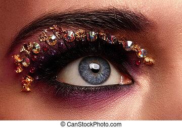primer plano, imagen, de, ojo, con, artístico, maquillaje