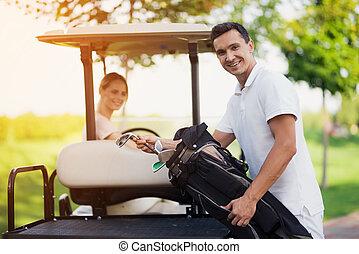 primer plano, mujer, golf, estantes, conducción, club,...