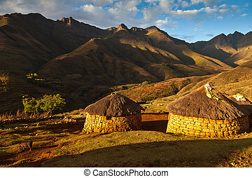 Primitive village in the mountains in beautiful light -...