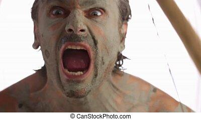 primitive warrior - primitive man doing fierce facial...