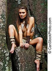 Primitive woman. Amazon woman - Woman warrior. Amazon woman....
