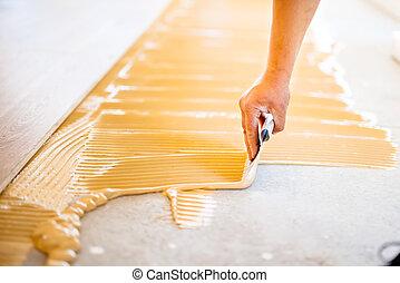 primo piano, di, mano, di, lavoratore, aggiungere, colla, durante, parquet, installazione