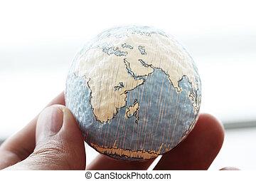 primo piano, di, uomo affari, mano, esposizione, struttura, mondo