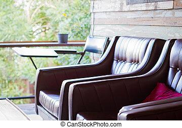 primo piano, sofà marrone, in, casa legno, con, copyspace
