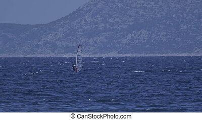 Primosten windsurfing - Surfing in the beautiful blue sea in...