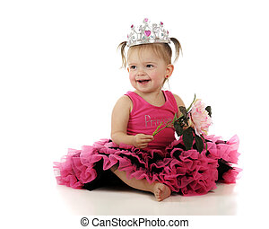 Princess Baby - A beautiful baby girl happily holding a...