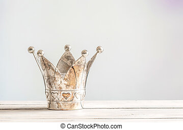 Princess crown on a wooden table - Princess crown with...
