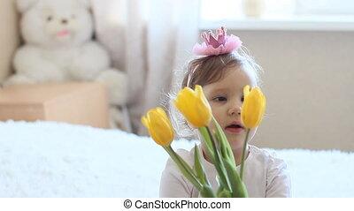 Princess girl with yellow tulips
