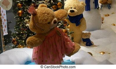 Princess toy brown teddy bear in a dress and crown spinning...