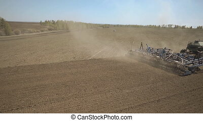 Principle of operation of sowing machine to tractor in field.