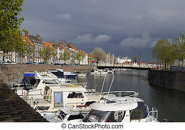 prins hendrikdok canal, middelburg - sunny cityscape with ...