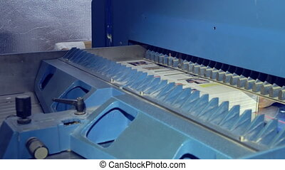 print factory - equipment for cutting edges person working...