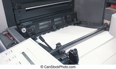 Print machine in working process in the printing house