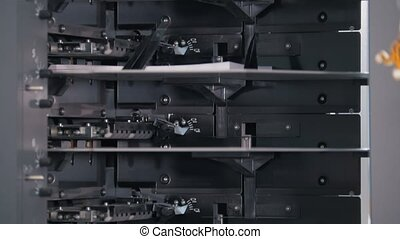 Print press equipment in the printing house, slow motion