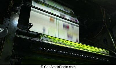 print shop machine detail yellow color close-up