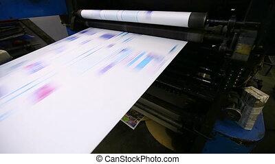 print shop typography machine work with cmyk newspaper