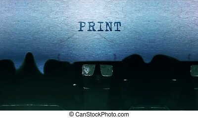 Print words Typing on a sheet of paper with an old vintage typewriter.