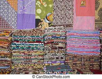 Printed bedsheets and other sheets on sale.