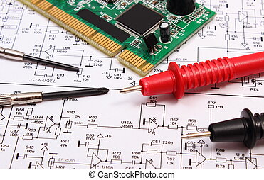 Printed circuit board with electrical components, precision tools and cable of multimeter on construction drawing of electronics, drawings and tools for engineer jobs