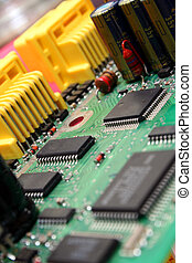 Printed circuit board with various electronics devices assembled on it.