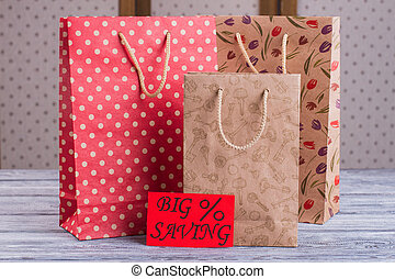 Printed paper shopping bags.